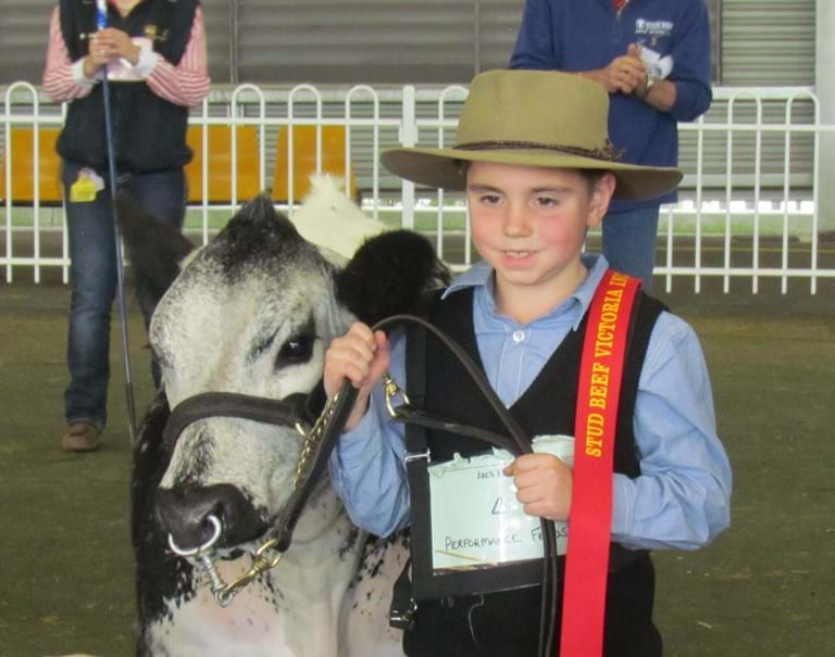 Jack Ellis wins his first ribbon for cattle showing